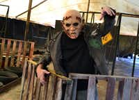 This undated image provided by Saint Lucifer's Haunted Asylum in Flint, Mich., shows a zombie awaiting his fate from paintball-shooting visitors.