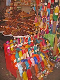 This January 2013 shows two traditional Moroccan products -- dates and leather slippers -- for sale in the souks inside Fez's medieval medina. Morocco's historic medinas are a haggling shopper's paradise.