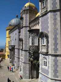 This May 2013 photo the colorful facade of Pena Palace in Sintra, Portugal. It's like a castle seen through a kaleidoscope, one of a number of spectacular buildings found in Sintra, which has long been a playground of royalty near the Portuguese capital of Lisbon. (AP Photo/Mike Corder)