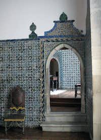 This May 2013 photo shows tiled walls and arched doorways inside the Monserrate Palace in Sintra, Portugal. The palace is one of a number of castles and other spectacular buildings found in Sintra, which has long been a playground of royalty near the Portuguese capital of Lisbon.