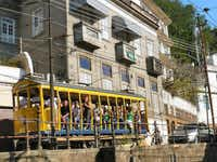 A century-old tram connecting the hilltop neighborhood Santa Teresa with the rest of Rio has operated in much the same way for a hundred years.( Colin Barraclough  - Colin Barraclough)