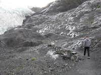 This photo taken Aug. 4, 2012, shows tourists walking to Exit Glacier in Kenai Fjords National Park just outside Seward, Alaska. The glacier is a popular destination for cruise ship passengers visiting the port city of Seward, about 110 miles south of Anchorage, Alaska.