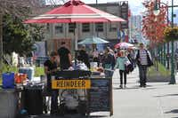 This photo taken June 7, 2013, shows hot dog vendors, or in this case reindeer dog vendors, set up in downtown, Anchorage, Alaska. There's plenty of cultural, historical and fun activities to do in Anchorage for cruise ship passengers who don't want to pay for expensive excursions.
