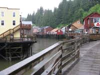 This August 2010 file photo shows a glimpse of Creek Street, a destination dotted with shops, galleries and restaurants, in Ketchikan, Alaska. This southeast Alaska town is now known more for tourism than its once-thriving timber industry.