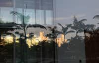 Art Deco buildings are reflected in the building's windows.