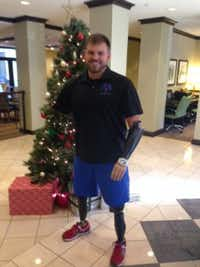 Travis Mills, 28, who lost all four limbs in an explosion in Afghanistan, was in Dallas Wednesday to sign his book, 'Tough as They Come'