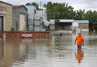 When the Trinity River drowned a business' parking lot just south of downtown at the end of May (Louis DeLuca/Staff photographer)