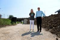 Shelly White, executive director of the Trinity Strand Trail, and David Demarest, chairman of the board for Friends of the Trinity Strand Trail, stand at the construction site of the Trinity Strand Trail, an 8-mile trail to connect the Katy Trail, Design District and Medical District.