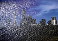 A double-exposure image shows the Dallas skyline framed in the Trinity River, an untapped natural resource and the heart of many a plan.Photo illustration by G.J. McCarthy - Staff Photographer