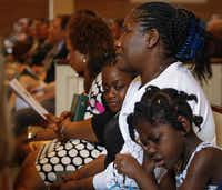 Louise Troh,  who was Duncan's fiancée, sat with her granddaughters Rose Yah (left), 6, and Knowledge Dopoe, 5, at Wilshire Baptist Church in Dallas on Easter Sunday. She wrote a book about her experiences.(Jim Tuttle - Staff Photographer)