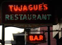 This March 25, 2013 photo shows a sign at the iconic New Orleans restaurant Tujague's in the French Quarter.
