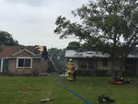 The aftermath of the morning's house fires in the Sparkman neighborhood in Northwest Dallas (Rose Baca/Staff photographer)