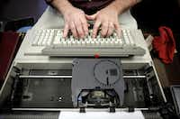 Ed Ellis tests an IBM Wheelwriter System electronic typewriter at Pickettt & Maxwell, P.C. Certified Public Accountants. Ellis says he can type 100 words a minute.