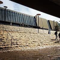 Water cascades down a stairway to a parking structure adjacent to Pauley Pavlion, home of UCLA basketball, background, after a 30-inch water main burst on nearby Sunset Boulevard Tuesday, July 29, 2014, in Los Angeles. Los Angeles Water and Power spokeswoman Michele Vargas says the water main, nearly a century old, would take another two hours to shut off. (AP Photo/Paul Phootrakul)Paul Phootrakul - AP