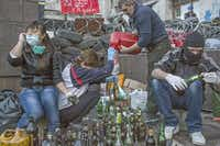 Pro-Russian protesters prepared Molotov cocktails outside the administrative building in Donetsk, Ukraine, on Tuesday. Protesters also began forming a parallel government.Mauricio Lima  -  The New York Times