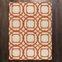 "Make a dramatic statement with Dallas-based Global View's ""Arabesque"" rug. It's Dallas designer Abbe Fenimore's favorite tangerine-hued piece in the online shop she curates, Shop Ten 25. The rug is 5 by 8 feet. $699. shopten25.com."
