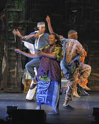 Ashley Duplechain (center, as a villager) appears in Mufaro's Beautiful Daughters, presented by Dallas Children's Theater.