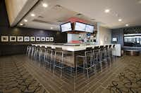 The sleek interior design of the Wheaton, Ill., Studio Movie Grill helps make the minutes go by faster for customers waiting to enter a theater.