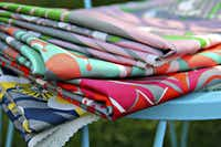The Carnival of Tides pattern is printed in several colorways on cotton or a linen-cotton blend.