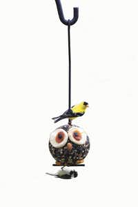 Hoot the Owl serves up seeds and dried fruits to chickadees, woodpeckers, goldfinches and other backyard birds. $10.99 at Wild Birds Unlimited, two Dallas locations.