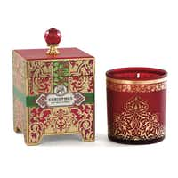 A 14 oz Christmas spice candle is festive in a gold printed, reusable glass container and decorative box with gold foil accents and glass knob.
