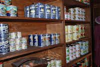 Canned goods, most of them replicas, line shelves at the general store.