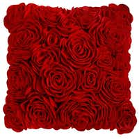 A delicate cluster of red, felt roses adorns a 16-inch square pillow. $39.95 at Pier 1 stores and Pier1.com.