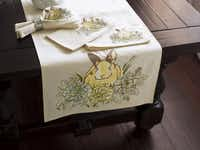 A crisp linen and cotton table runner is embroidered with a fanciful yellow bunny among spring blooms. $54.50. Set of four napkins is 29.50. At Dallas-area Pottery Barn stores and potterybarn.com.