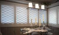 The innovative louvers of Texton's Mirage Shutters bend the light into unique patterns at a room's windows.