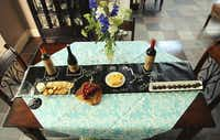 For a party, offer wine-pairing suggestions or label dishes on the line's table topper.