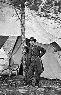 This June 1864 file photo shows former US Lt. General Ulysses S. Grant standing by a tree in front of a tent in Cold Harbor, Virginia. Grant was commanding general of all the Union forces during the US Civil War and was US President from 1869-1877.