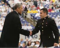 Chris Martinez shakes hands with President Barack Obama during his graduation ceremony from the United States Naval Academy last year. Ryan Martinez will graduate in 2015 and Jessica Martinez reports for freshman boot camp on July 1.Photo submitted by RICK MARTINEZ