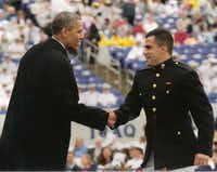 Chris Martinez shakes hands with President Barack Obama during his graduation ceremony from the United States Naval Academy last year. Ryan Martinez will graduate in 2015 and Jessica Martinez reports for freshman boot camp on July 1.(Photo submitted by RICK MARTINEZ)