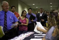 Job seekers picked up paperwork at a career fair in San Antonio last month. The state unemployment rate dropped to 6.6 percent in October.