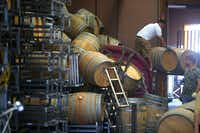 Workers move fallen wine barrels at Saintsbury Winery following a large earthquake in Napa, Calif., on Sunday, Aug. 24, 2014. (Aric Crabb/Bay Area News Group/MCT)Aric Crabb - MCT