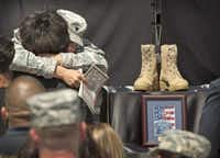 Spc. Kristen Haley, the fiancée of Sgt. 1st Class Daniel Ferguson, who was one of the three soldiers killed in the Fort Hood shooting last week, received condolences at Wednesday's memorial ceremony at Fort Hood.Jay Janner - Statesman