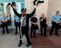 """Police have more respect for dogs than they do for black people,"" activist Anthony Shahid said at a rally Tuesday in Clayton, Mo., using stuffed toys to make his point.Laurie Skrivan - Dispatch"