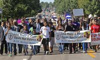 A march organized by area ministers makes its way through Ferguson, Mo., on Wednesday, Aug. 13, 2014. (J.B. Forbes/St. Louis Post-Dispatch/MCT)J.B. Forbes - MCT