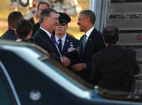 Mayor Mike Rawlings greets President Barack Obama at Love Field.