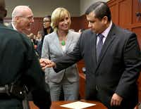 George Zimmerman's defense team congratulated him after he was found not guilty Saturday night in Sanford, Fla.Joe Burbank / Orlando Sentinel