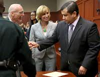 George Zimmerman's defense team congratulated him after he was found not guilty Saturday night in Sanford, Fla.(Joe Burbank / Orlando Sentinel)