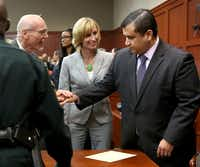 George Zimmerman is congratulated by his defense team after being found not guilty, on the 25th day of Zimmerman's trial at the Seminole County Criminal Justice Center, in Sanford, Forida, Saturday, July 13, 2013. Zimmerman had been charged with second-degree murder in the fatal shooting of Trayvon Martin, an unarmed teen, in 2012. (Pool photo/Joe Burbank/Orlando Sentinel/MCTJoe Burbank - MCT