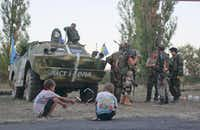 Captured Ukrainian soldiers sit in a cell in the rebel-held town of Starobesheve. On the battlefield, Russian troops have turned the tide in favor of Ukrainian separatists, while global leaders consider what to do.( Sergei Grits  -  The Associated Press )