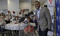"""""""We're here because of Family Place and what they do for our community,"""" former Dallas Cowboys star Darren Woodson told the more than 60 volunteers from Texas Instruments and Alliance Data working at the Safe Campus Tuesday.Nathan Hunsinger  -  Staff Photographer"""