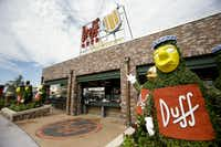 "This Sept. 5, 2013 photo shows the entrance to Duff Gardens, serving Duff beer, at ""The Simpson's"" themed Springfield USA at Universal Orlando in Orlando, Fla."