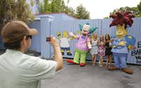 Parkgoers get their picture made with Krusty the Clown and Sideshow Bob.