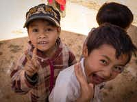 Children, unjaded, want their photo taken in Myanmar.Jonathan Look Jr.  -  Special Contributor