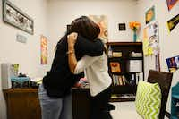 Gisell Barbosa, an eighth-grader at DISD's Raul Quintanilla Senior Middle School, embraces her mother, Maria Barbosa, after telling her she passed the STAAR tests. Before getting help from the school's urban specialist, Giselle would run away from home for months at a time and rarely attended class.(Rose Baca - neighborsgo staff photographer)