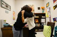 Gisell Barbosa, an eighth-grader at DISD's Raul Quintanilla Senior Middle School, embraces her mother, Maria Barbosa, after telling her she passed the STAAR tests. Before getting help from the school's urban specialist, Giselle would run away from home for months at a time and rarely attended class.Rose Baca - neighborsgo staff photographer