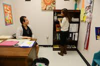 Gisell gets candy from Rodriguez's office at DISD's Raul Quintanilla Senior Middle School.Rose Baca - neighborsgo staff photographer
